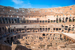 Colosseum or Coliseum indoor background blue sky in Rome, Italy. Colosseum background blue sky in Rome, Italy Stock Images