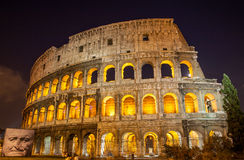 Colosseum(Coliseum) at night. In Rome, Italy stock images