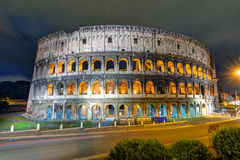 Colosseum (Coliseum) at night in Rome Stock Images