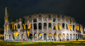 Rome Colosseum at night. The Colosseum, or the Coliseum, originally the Amphitheatrum Flavium, the largest amphitheatre in the world, is an elliptical royalty free stock photography