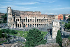 Colosseum (Coliseum) in Rome. Italy. The Colosseum is the main tourist attractions of Rome. It was built in the 1st century. Arch of Constantine on the right Royalty Free Stock Image