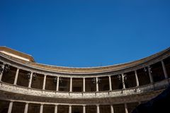 The Colosseum, columns and atrium of Alhambra palace, Granada, S. Pain, Europe on a bright sunny summer day with clear blue sky Stock Image