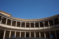 The Colosseum, columns and atrium of Alhambra palace, Granada, S. Pain, Europe on a bright sunny summer day with clear blue sky Royalty Free Stock Images