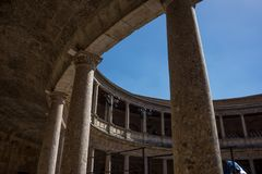 The Colosseum, columns and atrium of Alhambra palace, Granada, S. Pain, Europe on a bright sunny summer day with clear blue sky Royalty Free Stock Photos