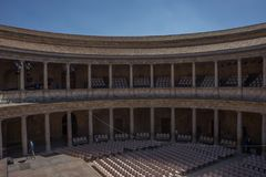 The Colosseum, columns and atrium of Alhambra palace, Granada, S. Pain, Europe on a bright sunny summer day with clear blue sky Royalty Free Stock Image