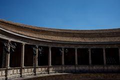 The Colosseum, columns and atrium of Alhambra palace, Granada, S. Pain, Europe on a bright sunny summer day with clear blue sky Royalty Free Stock Photo