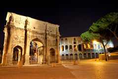 Colosseum and Constantine Arch. Colosseum and the Arch of Constantine in Rome, Italy at night Royalty Free Stock Photos