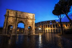 Colosseum and Constantine Arch at Night. With the light trails in the nearby road Stock Photos