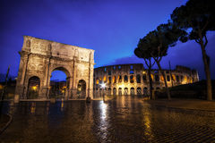 Colosseum and Constantine Arch at Night Royalty Free Stock Photos