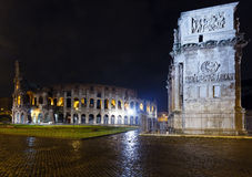 Colosseum and Constantine Arch night view, Rome. Royalty Free Stock Images