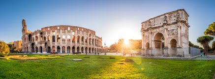 Colosseum and Constantine Arch at sunset, Rome, Italy stock images