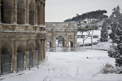 Colosseum and Costantine's Arch in the snow. This picture was taken february 4th 2012, after one of the heaviest snowfall in Rome since 1985. This is the view Royalty Free Stock Image