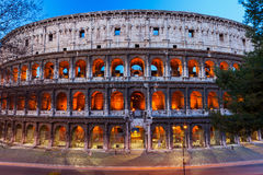 Colosseum at dusk Stock Images