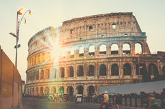 Colosseum in the evening in Rome, Italy. Sunlight through the Colosseum, Rome at sunset, famous landmark in the city in the evening night. Blurred people at the Royalty Free Stock Photo