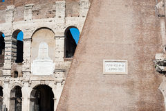 Colosseum exterior wall part with latin inscription Royalty Free Stock Photo