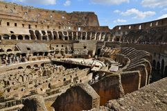 View inside the Colosseum, Rome. The Colosseum or Flavian Amphitheatre, Rome, showing the partially reconstructed floor and the catacombs Royalty Free Stock Photos