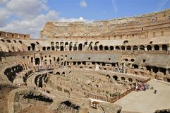 View inside the Colosseum, Rome. The Colosseum or Flavian Amphitheatre, Rome, showing the partially reconstructed floor and the catacombs Royalty Free Stock Photo