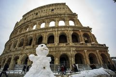 Colosseum and Fori imperiali, snow in Rome