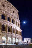 Colosseum and full moon, night view Royalty Free Stock Image
