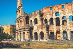 Colosseum i Rome under dagen Arkivbild