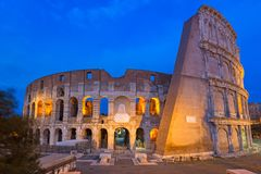 The Colosseum illuminated at night in Rome, Italy. Roman coliseum ancient landmark travel history dusk architecture italian monument twilight amphitheater royalty free stock photos