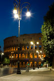 Colosseum and lantern. Colosseum with street view and lantern at night Royalty Free Stock Images