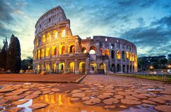 Free Colosseum Morning In Rome, Italy. Colosseum Is One Of The Main Attractions Of Rome. Coliseum Is Reflected In Puddle. Stock Images - 186264504