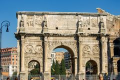 The Colosseum, and the nearby Arch of Constantine stock images