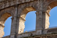The Colosseum, and the nearby Arch of Constantine royalty free stock images
