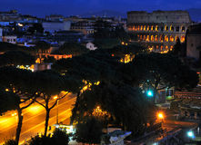 Colosseum by Night. The Colosseum and Via dei Fori Imperiali viewed from the Capitol Hill stock photography