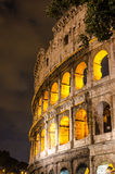 Colosseum at night. Colosseum of Rome at night with nice cloudy sky in background Stock Image