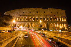 Colosseum at night with colorful blurred traffic lights Royalty Free Stock Photo