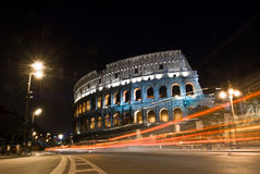 Colosseum in at Night, Rome, Italy. The Colosseum in Rome, Italy at night as traffic passes by.  The Colosseum was built in the 70s AD.  It was the largest Stock Photos