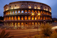 Colosseum, at night, landmark attraction in Rome - Italy Royalty Free Stock Image