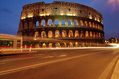 Colosseum, at night, landmark attraction in Rome - Italy Stock Photography