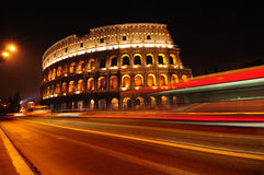 Colosseum at night in Rome, Italy. Colosseum and traffic lights at night in Rome, Italy