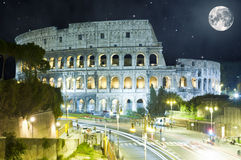 Colosseum at night, Rome, Italy with huge Moon Stock Images
