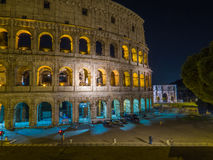The Colosseum by night. Night view of the Colosseum and the Arch of Constantine. In Rome, Italy Stock Photos