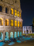 The Colosseum by night. Night view of the Colosseum and the Arch of Constantine. In Rome, Italy Stock Photography