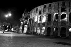 The Colosseum - Night view in Black and White. The Colosseum in Rome, the world famous landmark. Night view in black and white Stock Photo