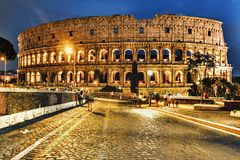 The Colosseum night view from the road royalty free stock photography