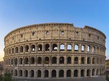 Colosseum på soluppgång i Rome Arkivbild
