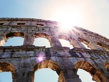 Colosseum Pula. Amphitheatre in Pula, ancient Roman Arena with the sun above Stock Photos
