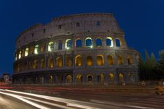 The Colosseum or Roman Coliseum at dusk with streaked car lights, originally the Flavian Amphitheatre, an elliptical amphitheatre  Royalty Free Stock Photos