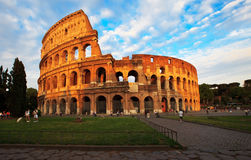 Colosseum in Rome. Just before sunset. Many tourists walking nearby one of the most known landmark of Italy. Photo taken 21st May 2011 royalty free stock images