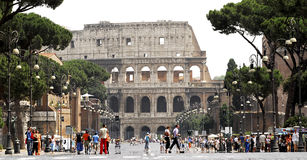 The Colosseum, Rome. Approaching the mighty Colosseum in Rome down Via dei Fori Imperiali Stock Photo