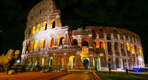 Colosseum in Rome - beautifully illuminated at night - Colosseo di Roma Stock Images