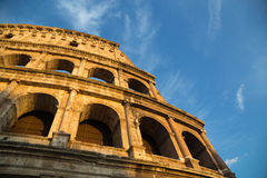 Colosseum in Rome with blue sky at day Stock Photo