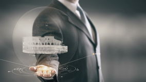 Colosseum Rome Businessman Holding in Hand Landmark New technologies. Businessman in the future with futuristic technology with landmark stock footage