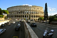 Colosseum, Rome. The Colosseum or Flavian Amphitheatre, Rome, with traffic in the foreground Stock Photo